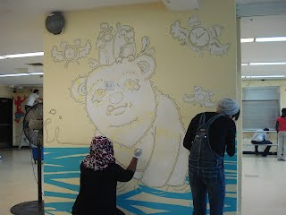 Muralist Alexis Wuyts designed the new murals for the 8th Floor student cafeteria.